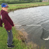Young Joe from Chesterfield with his first caught trout which took a dry fly.